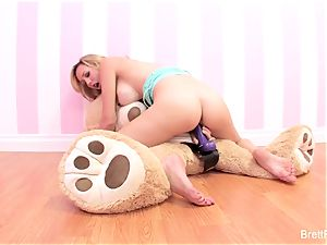 Brett Rossi plays with a stuffed bear's strap-on faux-cock