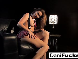 Dani gets off toying with her taut twat