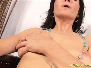 horny mother groping her raw labia