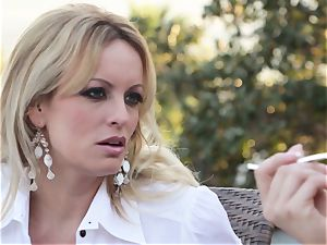 Stormy Daniels deep throats off a stranger in the back seat