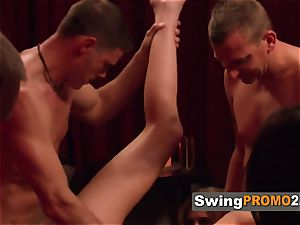 Swingers unclothe their clothes off as they make-out in the backyard