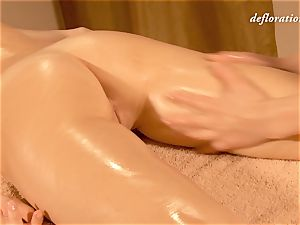 Elena being lube massaged by another lady