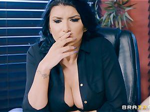 insatiable black-haired milf Romi Rain slammed in the booty in the office
