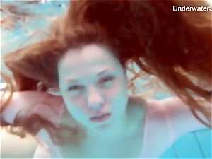 red-haired Simonna displaying her bod underwater